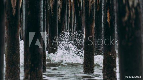 Beach water wave splash poles wood under bridge pier